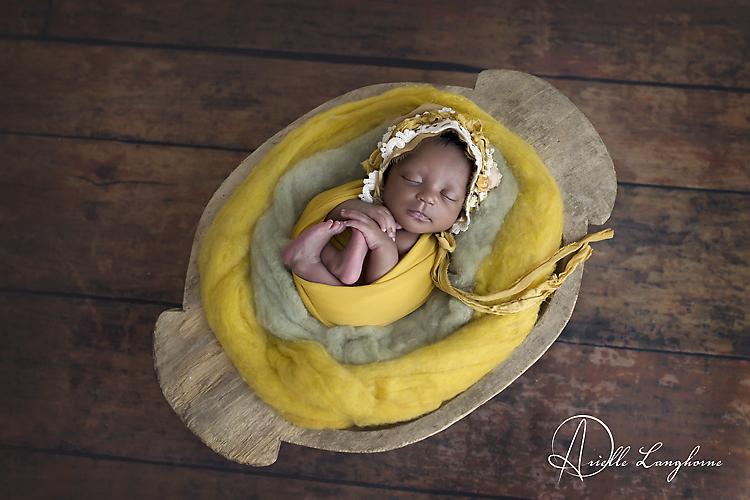newborn in bowl