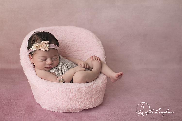 newborn in a chair