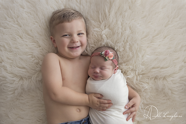 Newborn and big brother pose ideas