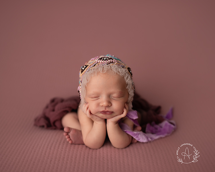Baby in froggy pose