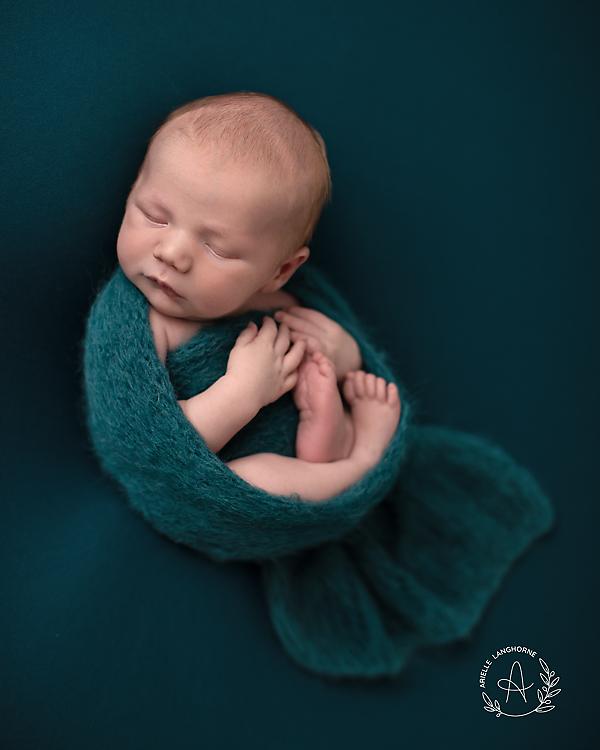cute baby in a wrap